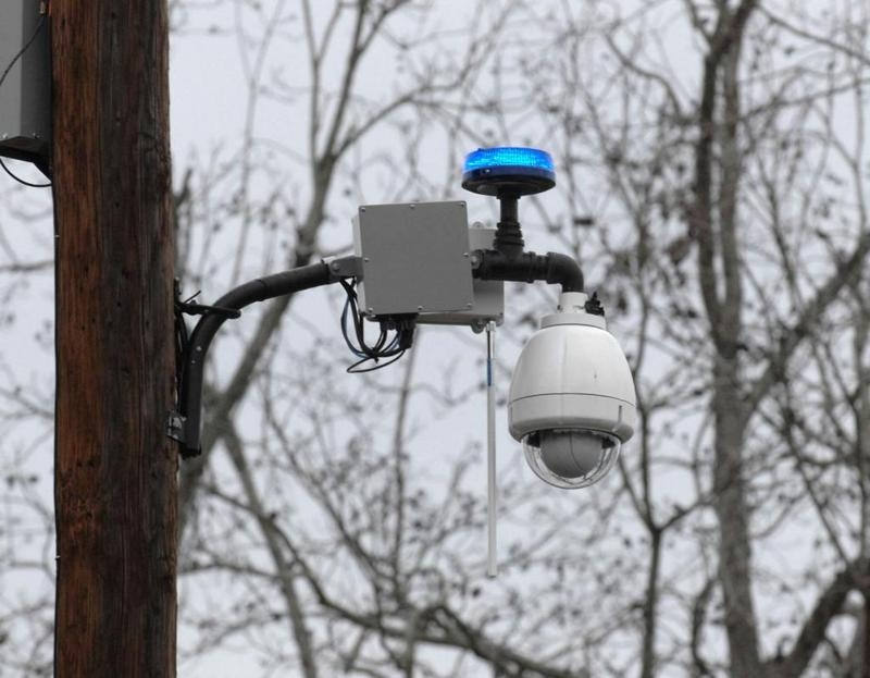 A Savannah-Chatham Metro Police surveillance camera mounted to a utility pole at the corner of 35th Street and Waters Ave. can be monitored by police via the internet. The camera can also zoom in and out and rotate 360 degrees.(John Carrington/Savannah Morning News)